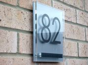 Cayman double acrylic house number sign with the iconic contrasting fixing plate by Plastic Republic. Size 200 x 200mm £41.99