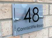 Classic Marletti shape T1 double acrylic house number sign with chrome stand off fixings by Plastic Republic. Size 210 x 148mm Price £24.98