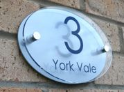 Oval shaped Marletti house number sign with chrome stand off fixings by Plastic Republic. Size 210 x 148. Price £24.98
