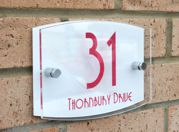 Modern Marletti double acrylic house number sign with chrome stand off fixings shape T4 by Plastic Republic.Size 210 x 148. Price £24.98