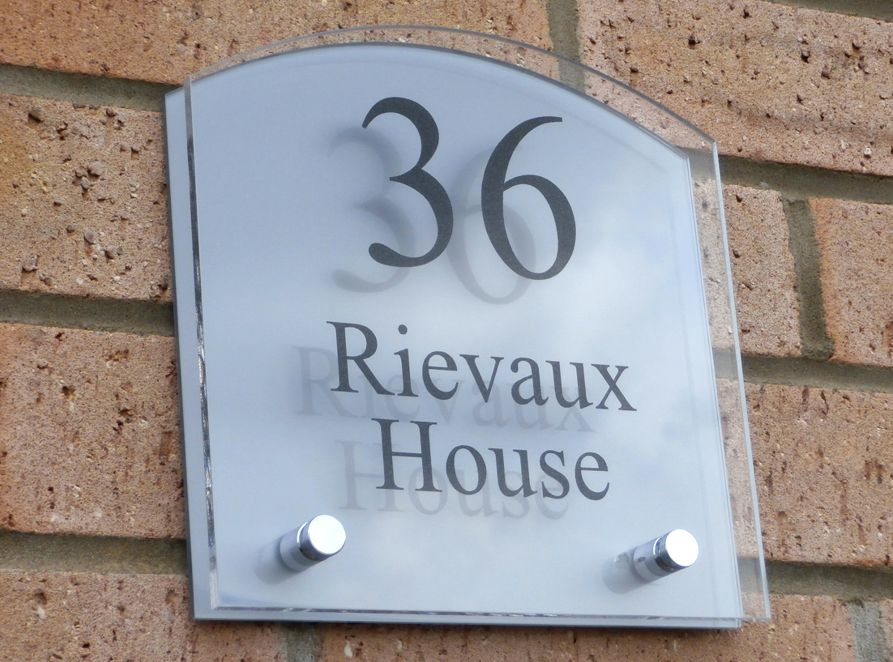 Sienna House number sign by Plastic Republic. More space for you to design a unique house plaque for your home. This T3 shape has a gently rounded top and incorporates two acrylic plates and chrome stand off fixings. Size 200 x 200mm. Price £39.98