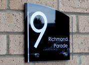 Sienna House number sign by Plastic Republic. More space for you to design a unique house plaque for your home. This T6 shape is very contemporary house number sign and incorporates two acrylic plates and chrome stand off fixings. Size 200 x 200mm. Price £39.98