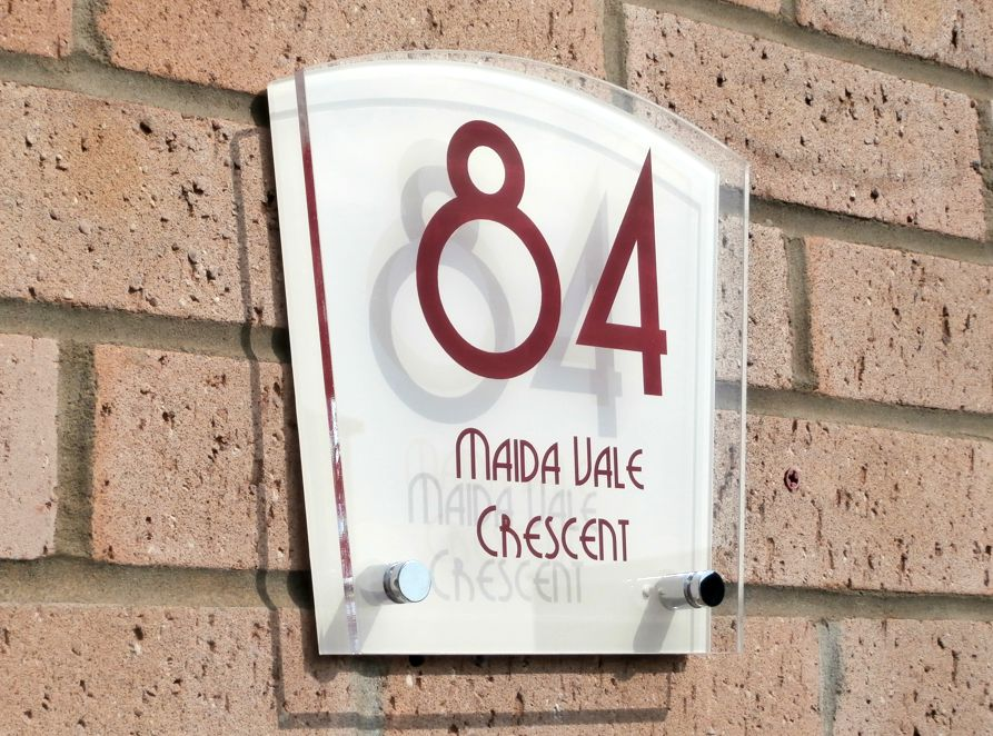 Sienna House number sign by Plastic Republic. More space for you to design a unique house plaque for your home. This T8 shape is an iconic house number design and incorporates two acrylic plates and chrome stand off fixings. Size 200 x 200mm. Price £39.98