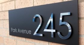 House number signs and plaques and individual cut numbers ...
